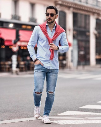 How to wear: hot pink crew-neck sweater, light blue vertical striped long sleeve shirt, blue ripped skinny jeans, white canvas low top sneakers