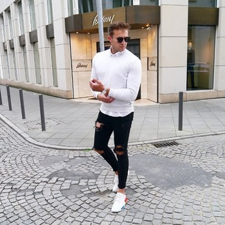 How to wear: white crew-neck sweater, white long sleeve shirt, black ripped skinny jeans, white low top sneakers