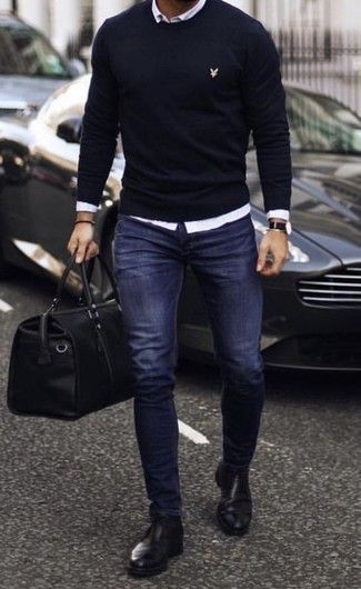 How to Wear a Black Leather Holdall For Men: For relaxed dressing with a fashionable spin, you can easily opt for a navy crew-neck sweater and a black leather holdall. And if you wish to instantly kick up this ensemble with a pair of shoes, why not introduce a pair of black leather chelsea boots to the mix?