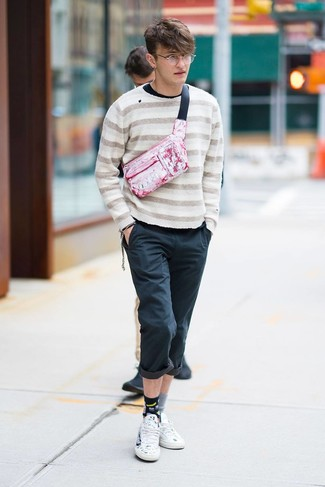 How to wear: beige horizontal striped crew-neck sweater, black long sleeve t-shirt, black chinos, white print leather low top sneakers