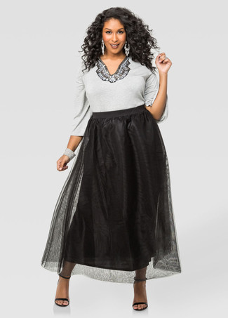 Go for a grey embellished crew-neck sweater and a black chiffon maxi skirt for a casual coffee run. A pair of black and tan leather heeled sandals will add some real flair to this look. If it's one of those gloomy fall days, what better to brighten things up than a chic outfit like this one?