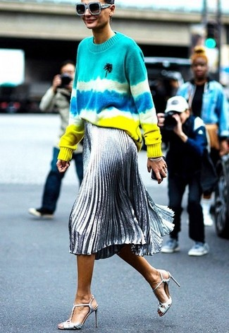 How to wear: multi colored tie-dye crew-neck sweater, silver pleated midi skirt, silver leather heeled sandals, light blue sunglasses