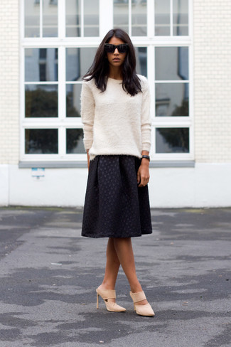 Women's Looks & Outfits: What To Wear In 2020: A white fluffy crew-neck sweater and a black pleated midi skirt are the kind of beyond chic casual items that you can wear for years to come. Not sure how to finish? Complement this ensemble with a pair of beige suede mules to bump up the oomph factor.