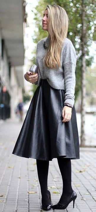 Wear a grey crew-neck sweater and a black pleated leather midi skirt for a glam and trendy getup. Dress up this look with black leather pumps.