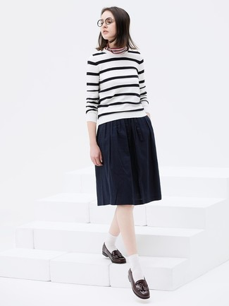 How to wear: white and black horizontal striped crew-neck sweater, navy pleated midi skirt, dark brown leather tassel loafers, multi colored horizontal striped bandana