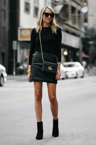 How to wear: black crew-neck sweater, black leather mini skirt, black suede ankle boots, black leather crossbody bag