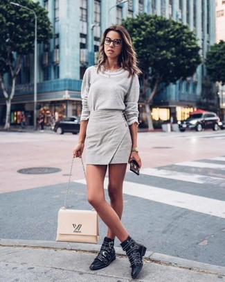 How to wear: grey crew-neck sweater, grey mini skirt, black studded leather ankle boots, beige leather satchel bag