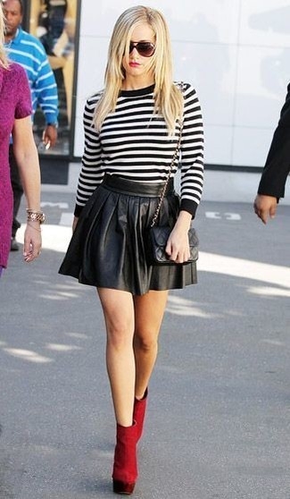 Consider teaming a black and white horizontal striped crew-neck sweater with a black pleated leather mini skirt for a glam and trendy getup. Elevate your getup with red suede booties.