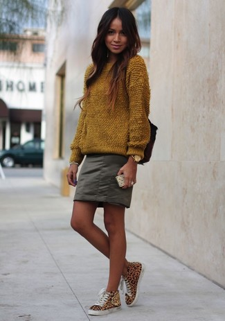How to wear: brown fluffy crew-neck sweater, olive mini skirt, tan leopard high top sneakers, gold watch