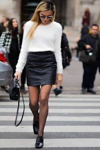 How to Wear Black Leather Oxford Shoes For Women: This pairing of a white fluffy crew-neck sweater and a black leather mini skirt is super easy to put together and so comfortable to rock over the course of the day as well! To give your look a classier finish, add black leather oxford shoes to the mix.