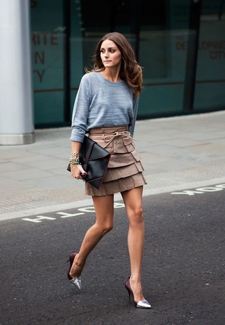 How to wear: grey crew-neck sweater, brown leather mini skirt, silver leather pumps, black leather clutch