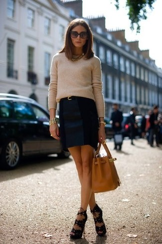 Stand out among other stylish civilians in a beige crew-neck jumper and a navy blue pencil skirt. Make black suede heeled sandals your footwear choice to instantly up the chic factor of any outfit.