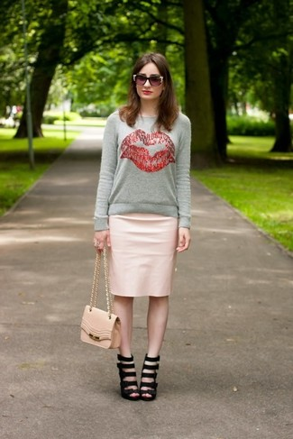 How to wear: grey print crew-neck sweater, pink leather pencil skirt, black leather heeled sandals, pink leather crossbody bag