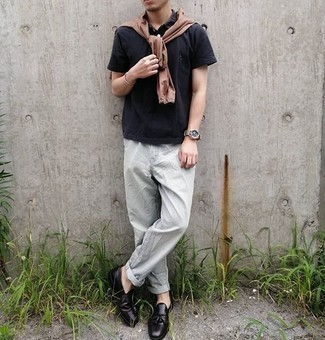 Black Polo with Chinos Outfits: To assemble a casual getup with a modern finish, pair a black polo with chinos. If you wish to instantly up the style ante of this look with shoes, why not complement this outfit with a pair of black leather tassel loafers?