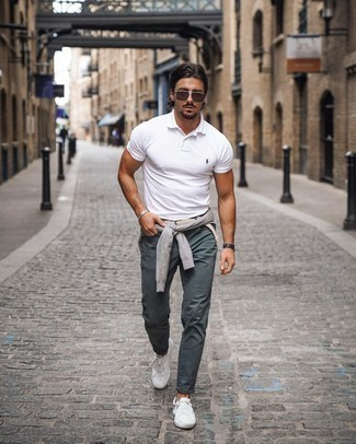 Belt Outfits For Men: If you're on the lookout for a laid-back but also dapper outfit, pair a grey crew-neck sweater with a belt. On the fence about how to finish off your look? Wear white canvas low top sneakers to kick it up.