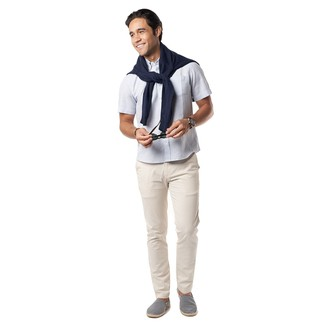How to wear: navy crew-neck sweater, white short sleeve shirt, beige chinos, navy and white canvas espadrilles