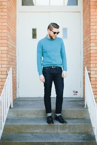 How to Wear Black Leather Oxford Shoes: This casual pairing of a light blue crew-neck sweater and navy jeans takes on different nuances depending on how you style it. To give this look a classier feel, why not complement this ensemble with black leather oxford shoes?
