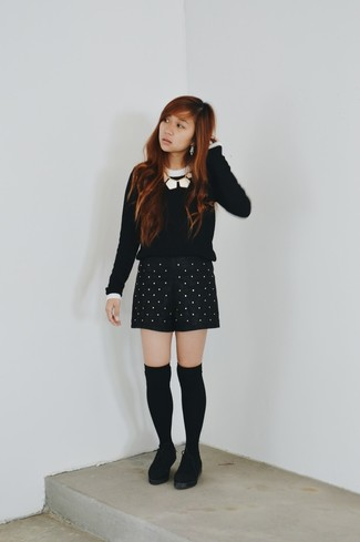 How to wear: black and white crew-neck sweater, black studded leather shorts, black suede ankle boots, black knee high socks