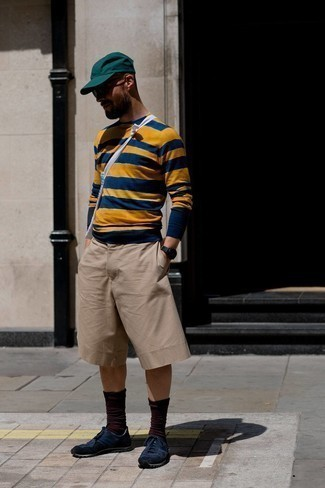 Navy Athletic Shoes Outfits For Men: A multi colored horizontal striped crew-neck sweater and tan shorts are a great combination worth having in your off-duty wardrobe. And if you want to instantly dial down your ensemble with one single item, add navy athletic shoes to this look.