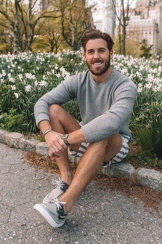 Silver Bracelet Outfits For Men: Go for a pared down yet cool and casual choice putting together a grey crew-neck sweater and a silver bracelet. And if you wish to easily ramp up this outfit with shoes, why not complete your ensemble with grey canvas boat shoes?
