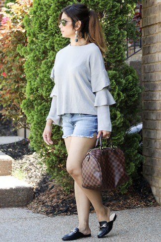 This combo of a grey ruffle crew-neck sweater and light blue denim shorts will attract attention for all the right reasons. A pair of Vince Camuto Vestata Leather Peep Toe Mule will add more polish to your overall look.  This outfit is likely to become your summertime favorite.