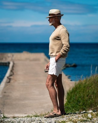 Beige Crew-neck Sweater Relaxed Outfits For Men: If it's comfort and functionality that you love in menswear, opt for a beige crew-neck sweater and white shorts. You could go down the casual route with shoes by finishing off with a pair of tan suede sandals.