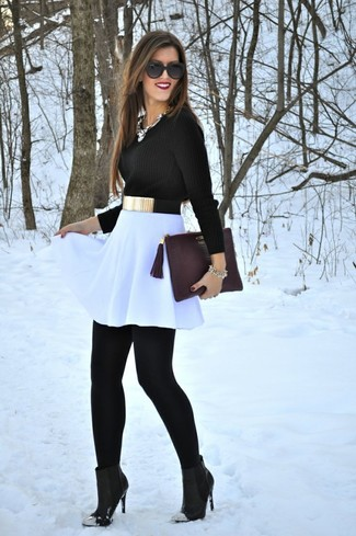 Choose a black crew-neck sweater and a white skater skirt to get a laid-back yet stylish look. Why not introduce black leather ankle boots to the mix for an added touch of style? You can bet this outfit will become your go-to come warmer weather.