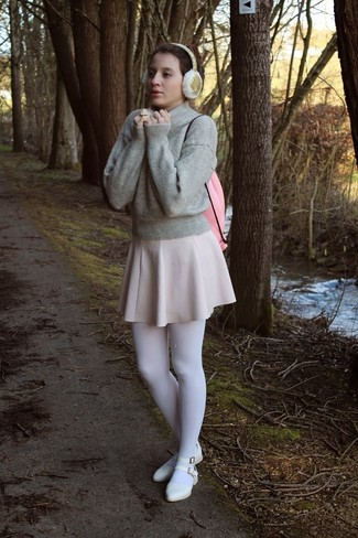 Opt for comfort in a grey crew-neck jumper and a beige skater skirt. Finish off your look with white leather ballerina flats.
