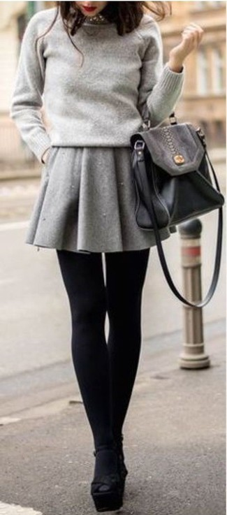 The versatility of a grey crew-neck sweater and an Isabel Marant Silver Rich Choker makes them investment-worthy pieces. A pair of black chunky suede heeled sandals adds some real flair to this getup. A knockout summer-to-fall outfit like this one makes it very easy to embrace the new season.