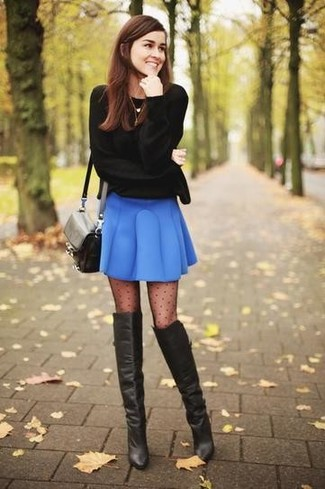 Wear a black crew-neck sweater with a blue skater skirt for a relaxed take on day-to-day wear. To add oomph to your getup, finish off with black leather over the knee boots. Loving that this combo is ideal when chillier days are here.