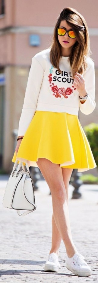 How to wear: white print crew-neck sweater, yellow skater skirt, white plimsolls, white leather satchel bag