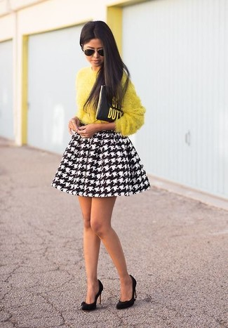 Consider wearing a yellow fluffy crew-neck pullover and a black and white houndstooth pleated skirt for a lazy Sunday brunch. Add black suede pumps to your look for an instant style upgrade.