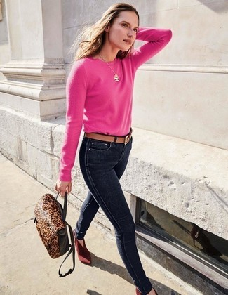 How to wear: hot pink crew-neck sweater, navy skinny jeans, burgundy suede ankle boots, dark brown leopard leather backpack