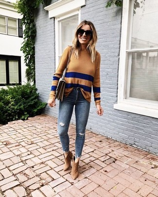 How to wear: tan horizontal striped crew-neck sweater, navy ripped skinny jeans, tan suede ankle boots, brown leather crossbody bag