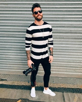 How to wear: white and black horizontal striped crew-neck sweater, black skinny jeans, white athletic shoes, black sunglasses