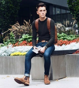 How to Wear Brown Suede Chelsea Boots For Men: A charcoal crew-neck sweater looks especially good when combined with navy skinny jeans. Complement this outfit with brown suede chelsea boots to kick things up to the next level.