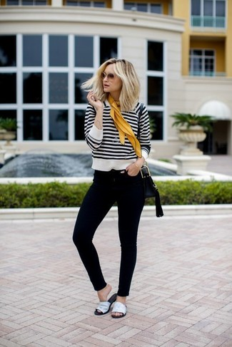 How to wear: white and black horizontal striped crew-neck sweater, black skinny jeans, white leather flat sandals, black leather crossbody bag
