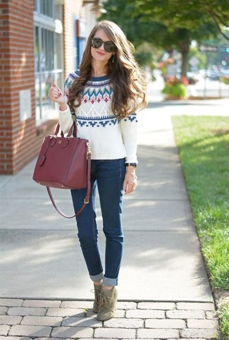 How to wear: white fair isle crew-neck sweater, navy skinny jeans, olive suede lace-up ankle boots, burgundy leather tote bag