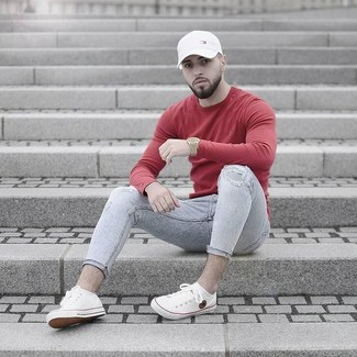 Men's Red Crew-neck Sweater, Grey Ripped Skinny Jeans, White Canvas Low Top Sneakers, White Baseball Cap