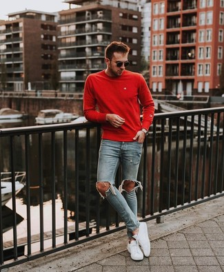How to wear: red crew-neck sweater, light blue ripped skinny jeans, white low top sneakers, black sunglasses