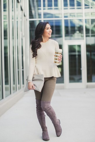 How to wear: beige crew-neck sweater, brown skinny jeans, pink suede over the knee boots, grey leather clutch