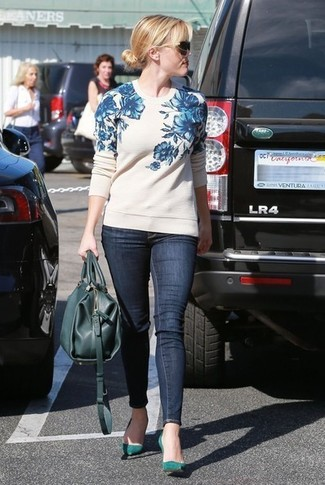 Reese Witherspoon wearing White and Blue Floral Crew-neck Sweater, Navy Skinny Jeans, Teal Suede Pumps, Teal Leather Tote Bag
