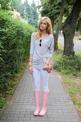 A grey crew-neck sweater and white slim jeans is a wonderful combination to carry you throughout the day. Mix things up by wearing rain boots.