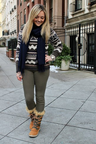 How to wear: brown fair isle crew-neck sweater, olive skinny jeans, tan snow boots, navy scarf