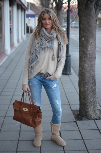 How to wear: beige fluffy crew-neck sweater, light blue ripped skinny jeans, beige uggs, brown leather satchel bag