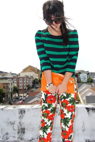 Women's Navy and Green Horizontal Striped Crew-neck Sweater, White and Red Floral Skinny Pants, Orange Leather Clutch, Gold Watch