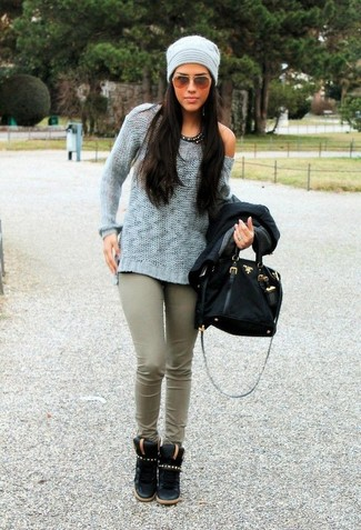 This combo of a light blue crew-neck pullover and olive green skinny pants will attract attention for all the right reasons. A pair of black suede high top sneakers brings the dressed-down touch to the ensemble.