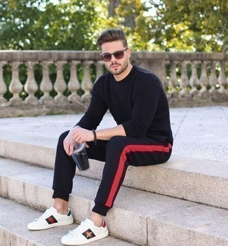 How to Wear Black Sweatpants In Warm Weather For Men: Want to inject your closet with some laid-back dapperness? Opt for a black crew-neck sweater and black sweatpants. This outfit is complemented really well with white print leather low top sneakers.