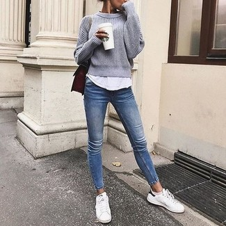 How to wear: grey crew-neck sweater, white tank, blue skinny jeans, white low top sneakers