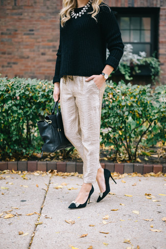 A black crew-neck sweater and beige silk tapered pants is a nice pairing to carry you throughout the day. And it's a wonder what a pair of black embellished suede pumps can do for the look. Loving this one, especially for spring.